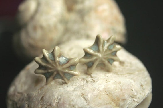 Ceramic and sterling silver stud earrings made from a mold of real shell