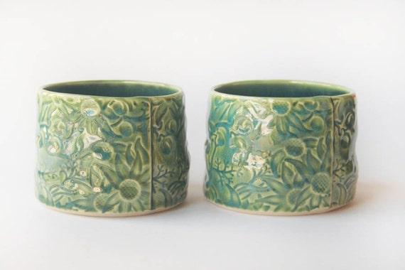 Pair of green ceramic 'Dessert Pots' with Australian Flannel Flowers