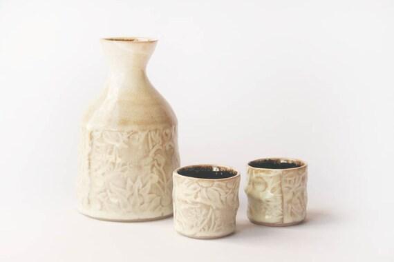 Sake set in white and bone glaze with Australian Flannel Flower design
