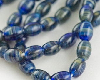 5x7mm Vibrant Midnight Blue Swirl Vintage German Glass Capsule Beads - 6 inch strand - 25 pieces