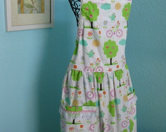 Summer Days Apron, women, teens, white with trees, bikes, birds, pockets full coverage