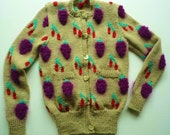 Hand Knitted fruity cardigan from original pattern book of Patricia Roberts.
