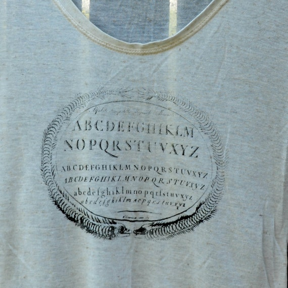 Soft Ivory scoop neck shirt with vintage style typographic screenprint of the alphabet