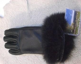 Ladies Lambskin gloves with possum trim.
