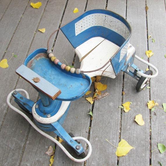 Vintage 1950's blue Taylor-Tot baby walker and stroller