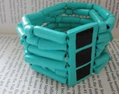 turquoise colored 66 piece handmade bracelet