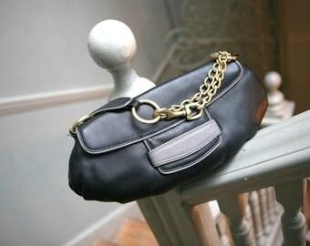 50% off Oversized Clutch handmade with real leather. Leonie Saliba