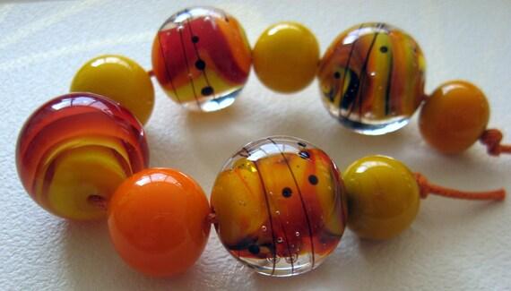 Reserved for Sandra - Feel the Sun - Handmade Lampwork Bead Set (9) by Anne Schelling, SRA
