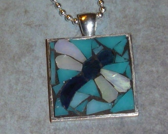Mosaic blue dragonfly with blue background pendant