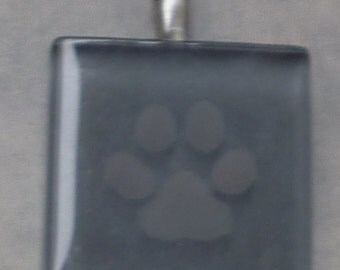 Etched glass stormy gray paw print pendant