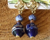 A vintage navy blue earrings, clip on.