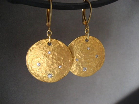 Gold disc earrings with hand set cubic zirconia