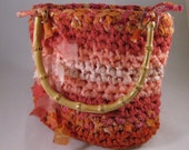 Crochet purse rag bag in coral, pink and orange fabrics with bamboo handles, recycled and repurposed materials