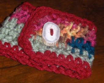 The Fun House Hodge Podge Colored with Jellied Cranberry.  Handmade Crocheted Coffee Cup Cozy with Deer Antler Button