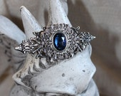 Edwardian Brooch/Hair piece with blue sparkle Bermuda rhine stone. Gothic style