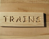 "Wooden sign ""TRAINS"""