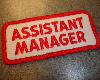 Red And White Collectible Assistant Manager ID Patch  Ironic