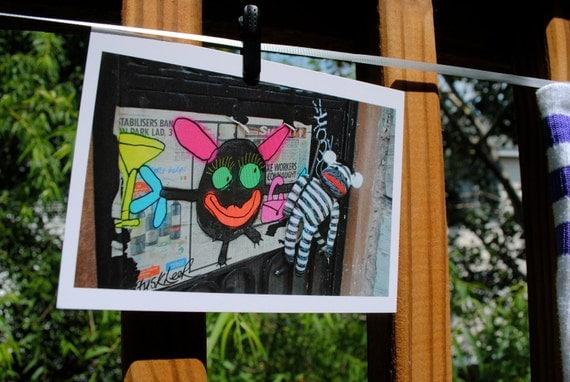 Sock Monkey With NYC graffiti girlfriend postcard