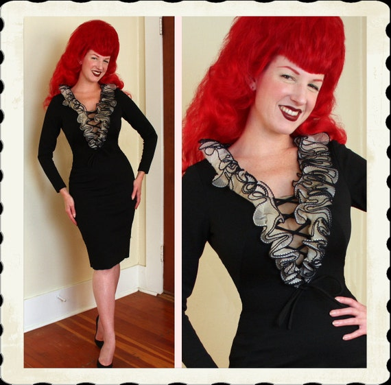 BOMBSHELL Early 1960's Inky Black Hourglass Cocktail Dress w/ Lace Up Illusion Bust & Ruffle Neckline by Designer Sydney North - Size M