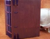 Plum colored coptic stitch book