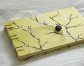 Cherry blossoms on sunshine yellow photo album, journal, or wedding guest book