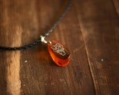Amber pendant Fiery Orange unisex necklace with Handcarved Deer silhouette