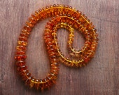 Golden orange Baltic Amber Long graduated Bead necklace