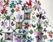 White Poncho in colorful Crosstitch -  Handmade Animal and Flower Folk style ornaments