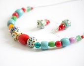 Bright handmade Glass bead necklace on chain in Green Red Blue