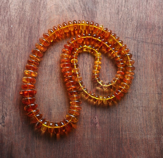 Golden orange Baltic Amber Long graduated Bead necklace