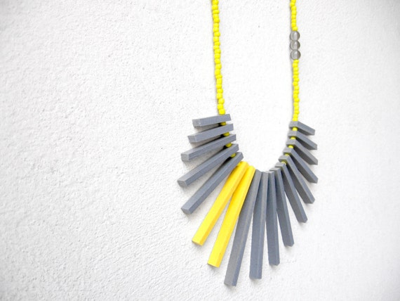 neon geometric necklace with grey and yellow sticks and beads