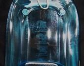Melted Blue Bombay Sapphire Bottle