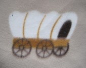 Covered Wagons and Horses on Beige with Green 2 Layer Blanket