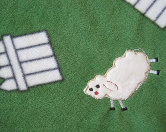 Barns, Picket Fences and Fluffy Sheep on Green with Gray Fleece Blanket