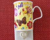 Flowers and Butterflies Cover This Nightlight Made From A Bone China Mug