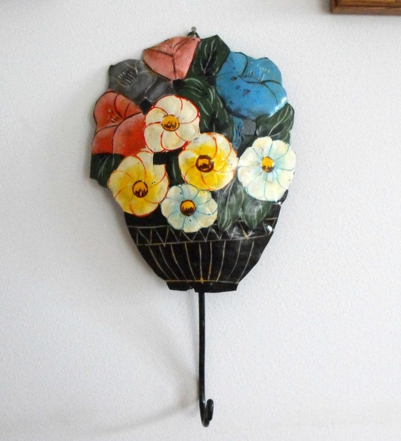 Vintage Metal Wall Hook With a Vase of Bright Colored Flowers