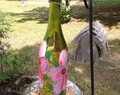 Recycled wine bottle bird feeder