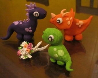 Customized dinosaurs family  cake toppers