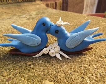 Blue kissing love bird clay cake topper