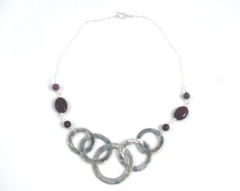 Sterling silver intertwined circlet necklace with tourmaline stones