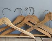 vintage set of wooden hangers - five