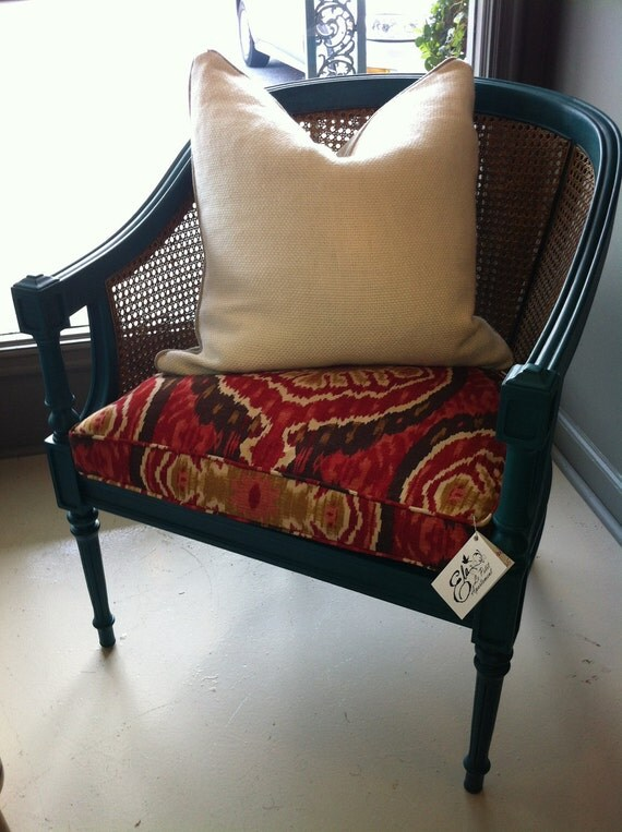 The Molly Chair Teal Green and Gold Vintage Cane Chair with Ikat Fabric Seat.