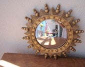 Vintage gold sunburst mirror