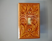 Electric switch cover plate, hand carved