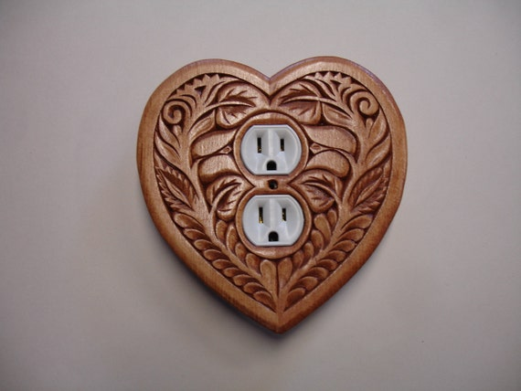 Heart shaped, uniquely designed, electric outlet cover plate