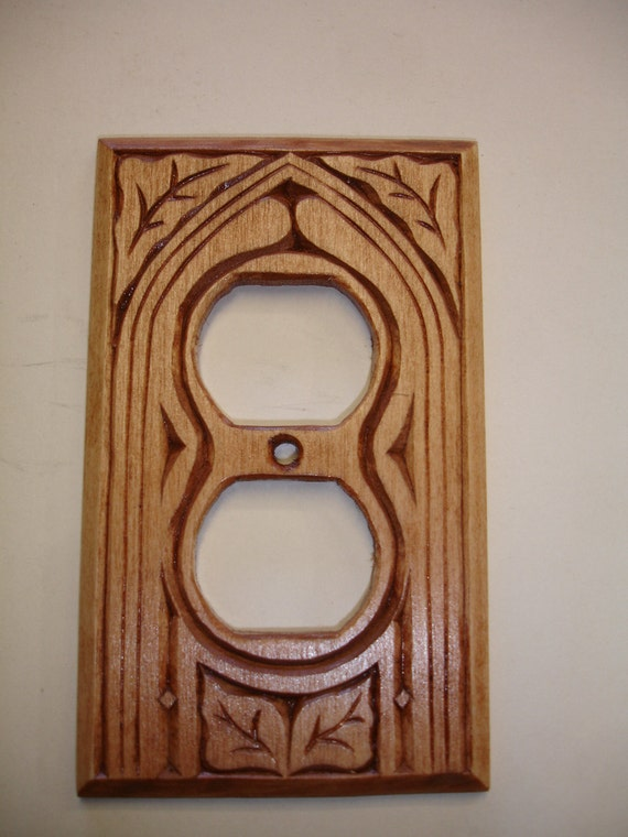 Hand carved electric outlet cover plate