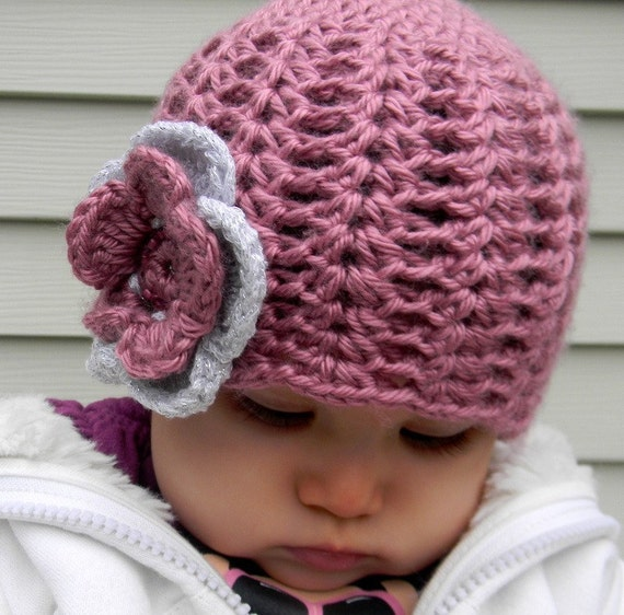 Pink beanie for girls with a flower and beads