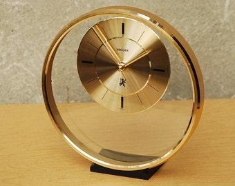 Kruger Floating Lucite Gold Round Mantel Clock