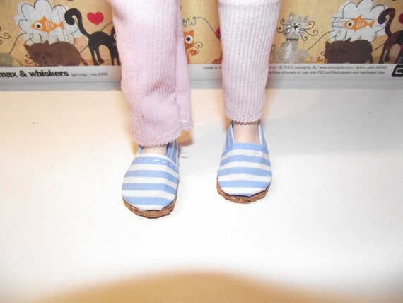 Cute pair of white and blue striped slip on flats shoes for Taeyang