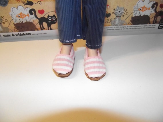 Cute pair of white and pink striped slip on flats shoes for Taeyang